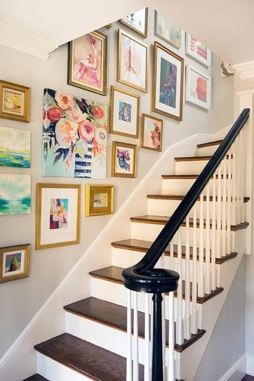 home-decor-wall-gallery-gold-frames-stairs-contemporary