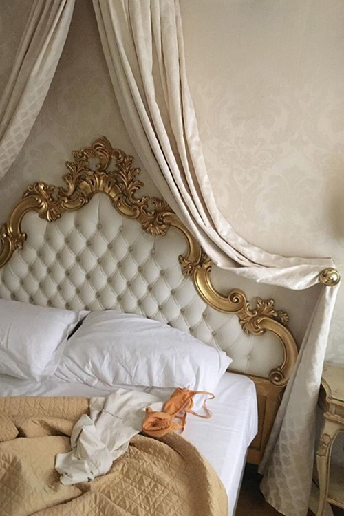 bedroom-parisian-bed-tufted-headboard-drapes-gold-bronze-chic-glamourous-rococo-baroque