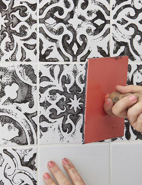Stamped-painting-tiles-black-and-white-bathroom-wall