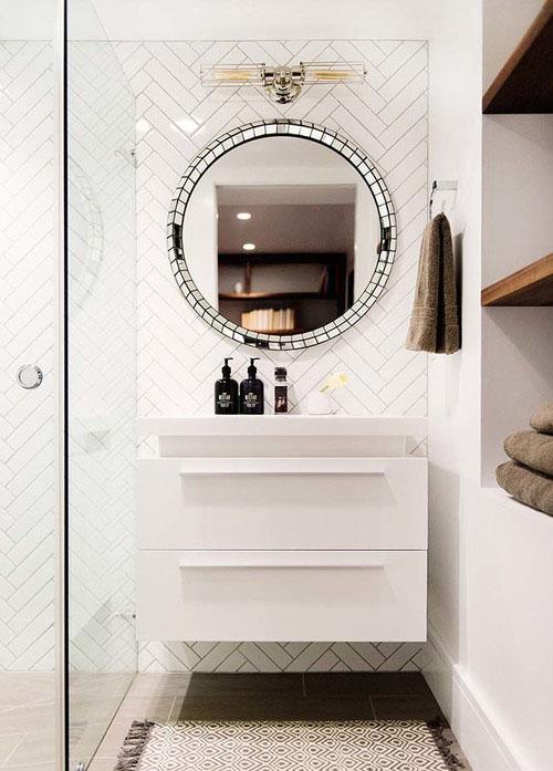 white-vanity-round-mirror-bathroom
